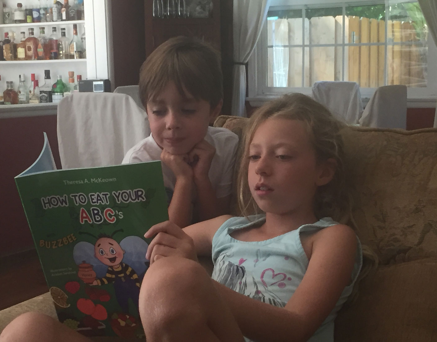 Siblings Reading Together